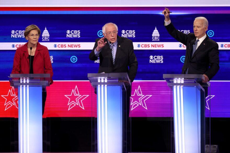 Democratic presidential candidates (L-R) Sen. Elizabeth Warren (D-MA), Sen. Bernie Sanders (I-VT) and former Vice President Joe Biden participate the Democratic presidential primary debate at the Charleston Gaillard Center in Charleston, South Carolina.