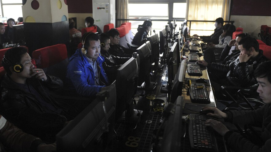 """Chinese authorities go to great lengths to censor the Internet and control social media. A 16-year-old was recently arrested under a new law that bars """"rumormongering"""" online. Here, customers use computers at an Internet cafe in Hefei, China, in 2012."""