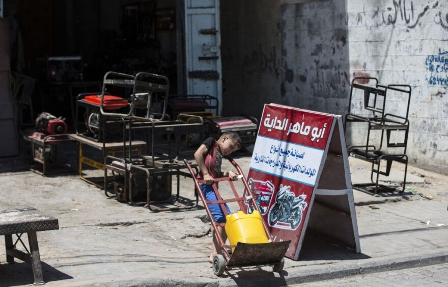 A Palestinian boy pulls a water-filled jerrycan during a heatwave at al-Shati refugee camp in Gaza City earlier this month.
