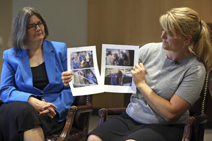 Nurse Alex Wubbels (right) displays video frame grabs of herself being taken into custody while her attorney, Karra Porter, looks on during an interview Friday. Wubbels was arrested after she told a police detective it was against hospital policy to conduct a blood draw from an unconscious patient without a warrant.