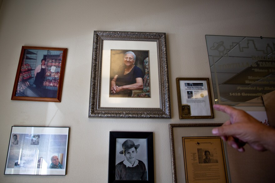 An assortment of photos and frames hang on the main wall of the shop. A photo of Elvira Leal, the founder of Dallas Tortilla and Tamale Factory, is front and center.