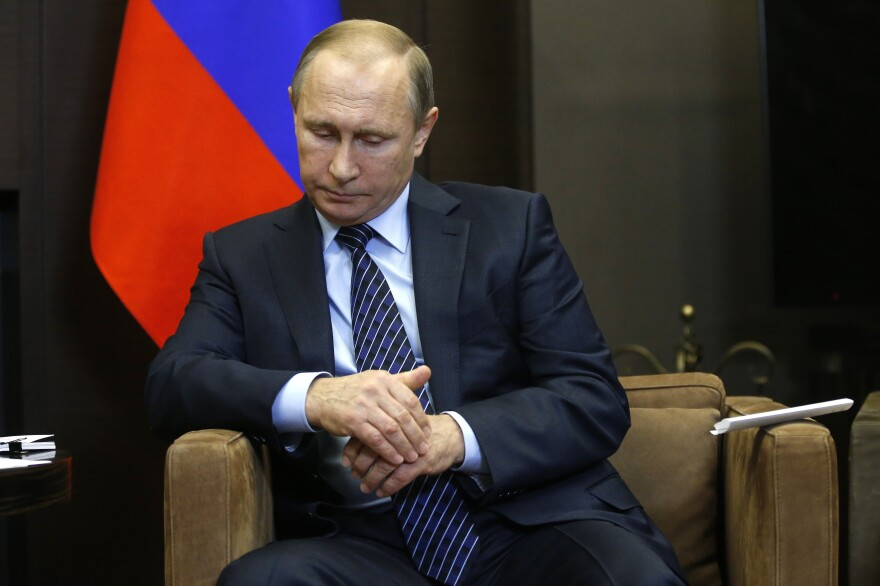 "Russian President Vladimir Putin is shown during a meeting with Jordan's King Abdullah II in Sochi, Russia, on Tuesday. Putin said Turkey's downing of a Russian warplane was ""a stab in the back."""