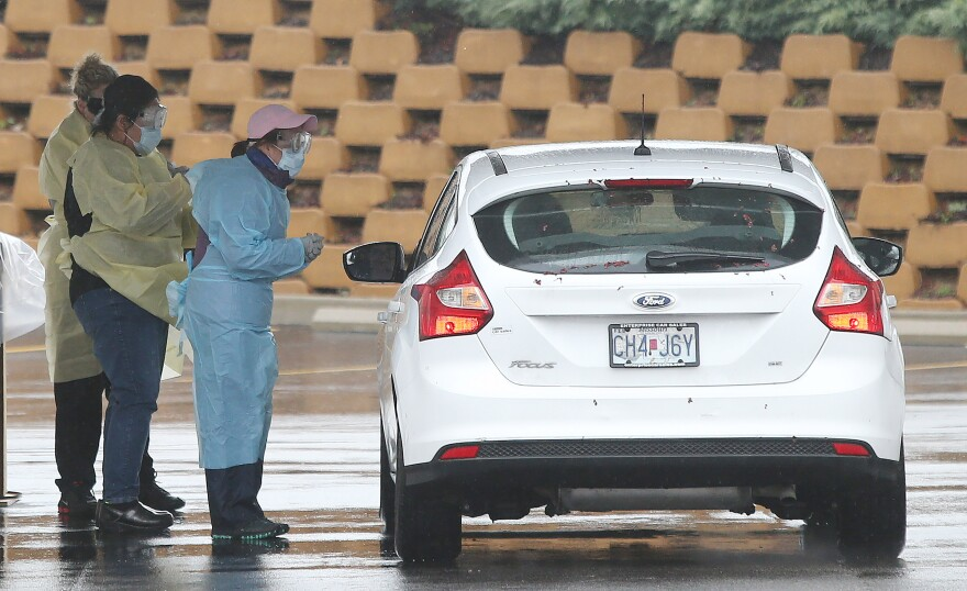Nurses greet a patient in their car to be tested for the COVID-19 at the Mercy Virtual Care Center in Chesterfield on Saturday morning. Missouri has four known cases of the new coronavirus virus as of Friday evening. 3/14/20