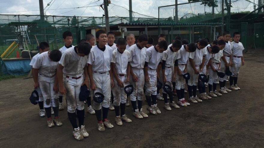 The Musashi Fuchu players show proper manners by bowing to the field ahead of practice on the outskirts of Tokyo.