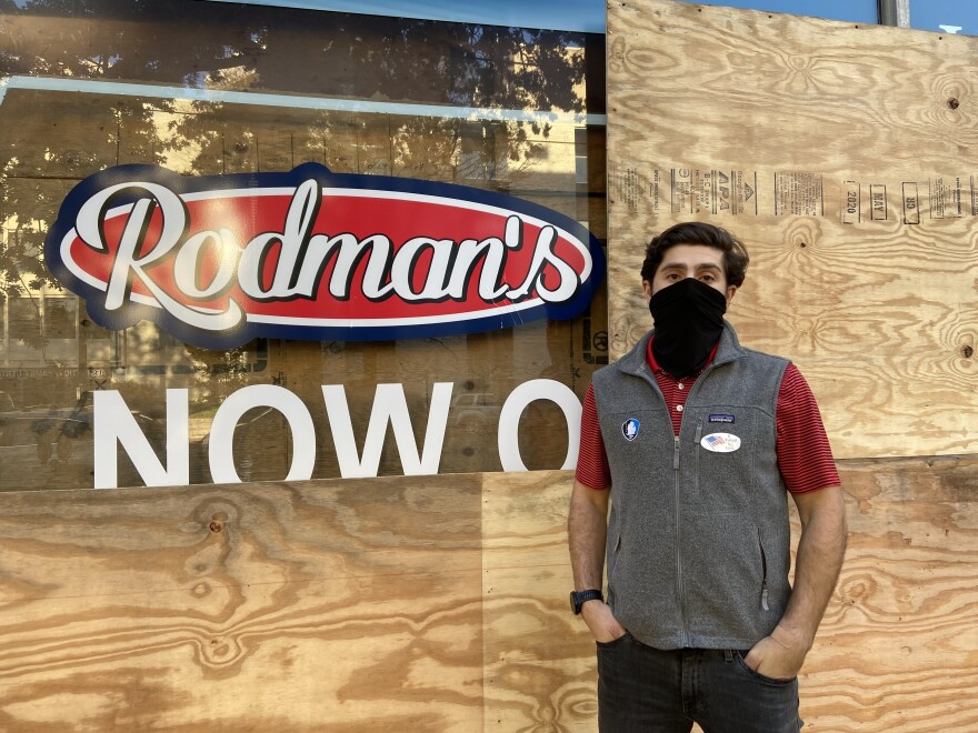 Nolan Rodman stands in front of the boarded up Rodman's Food and Drug in Washington, D.C. From coast to coast, cities are preparing for possible protests, civil unrest and violence, regardless of the election's outcome.