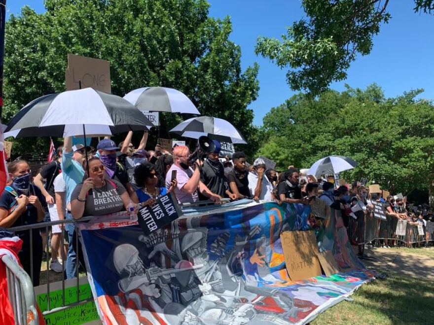 Protesters gather outside Gateway Church in Dallas.