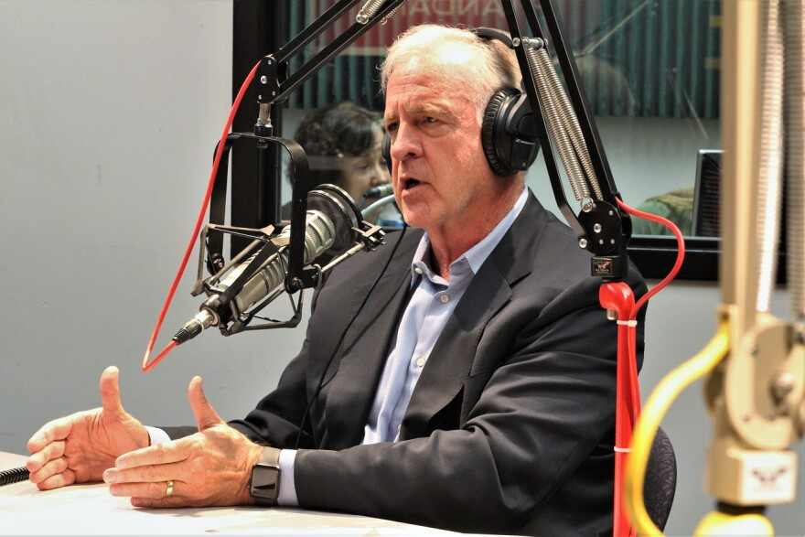 David Steelman wearing headphones while seated in front of a microphone in the KCUR studio.