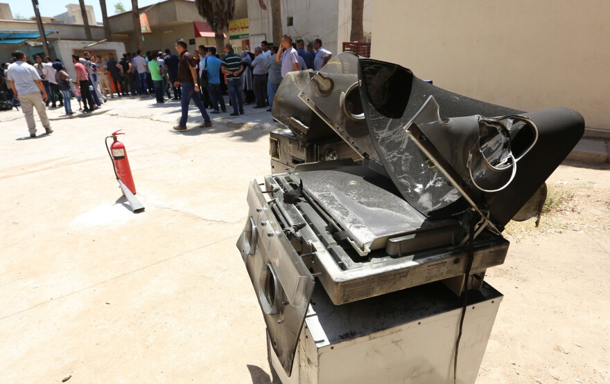 Burnt incubators stand outside Yarmuk hospital in west Baghdad on Wednesday, after an overnight fire killed at least 11 babies. <em>The New York Times</em> reports that the fire broke out at a ward for premature babies.