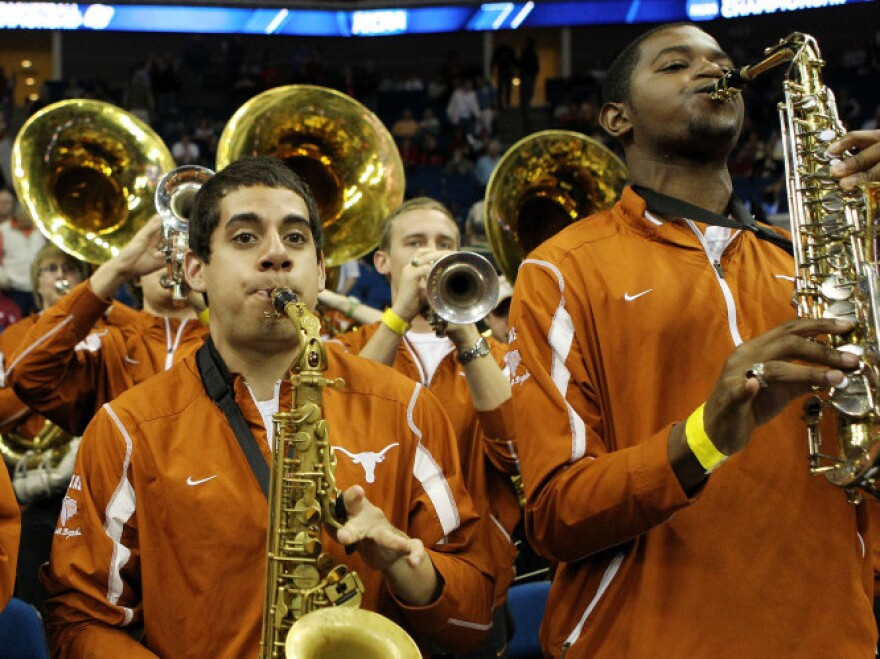 <p>The Texas Longhorns band performs during a basketball game against the Oakland Golden Grizzlies on March 18. A challenge to the admissions policy at University of Texas, Austin, contends that the school does not need to consider race to achieve a diverse student body. </p>