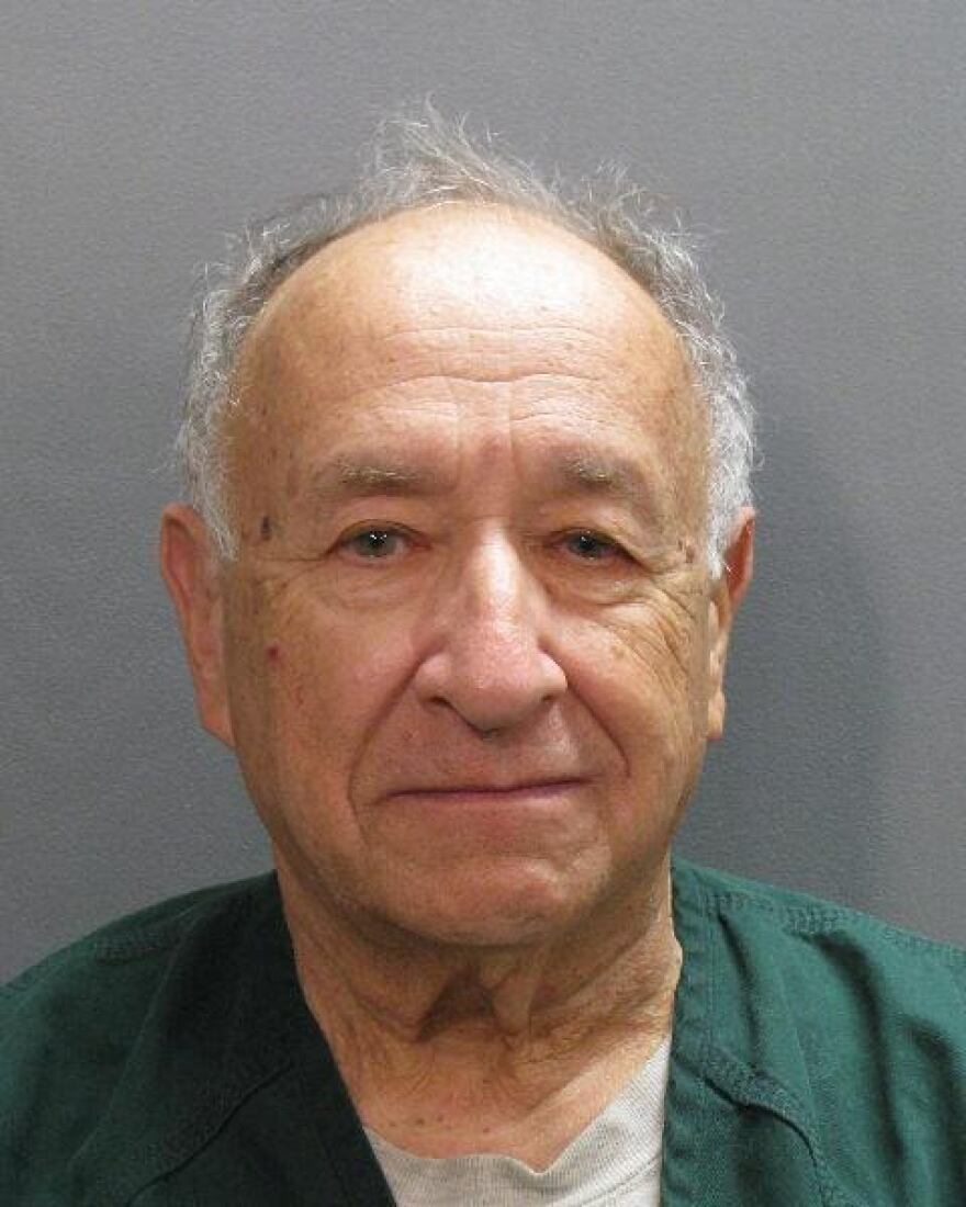 Dr. Howard Schneider's booking photo.