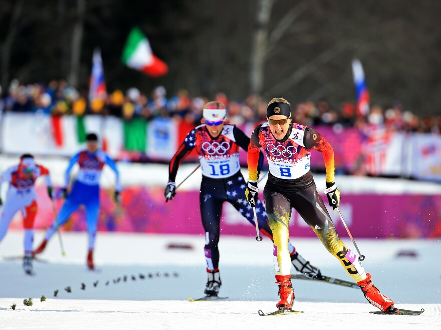 Kikkan Randall of the United States (left) and Denise Herrmann of Germany compete in the finals of the Ladies' Sprint Free during the Winter Olympics in Sochi, Russia.