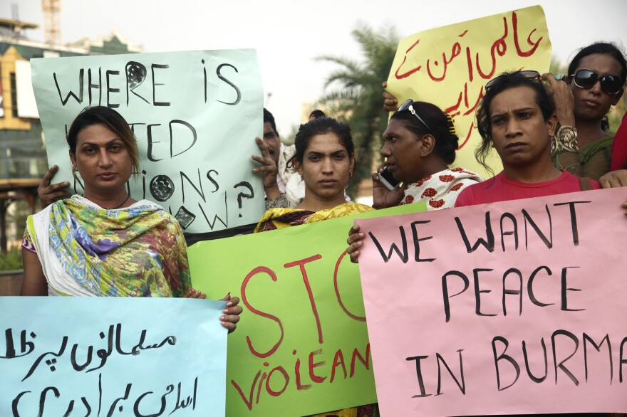 Ashi (third right, on phone) organizes a protest of two dozen transgender women in central Lahore, to condemn Myanmar's treatment of Rohingya Muslims. The demonstration is a way of showing transgender women are concerned citizens and good Muslims.