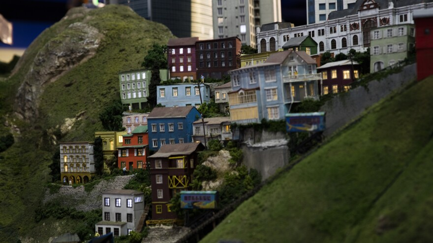 Tiny houses are lit from inside in this miniature model of Valparaíso, Chile.