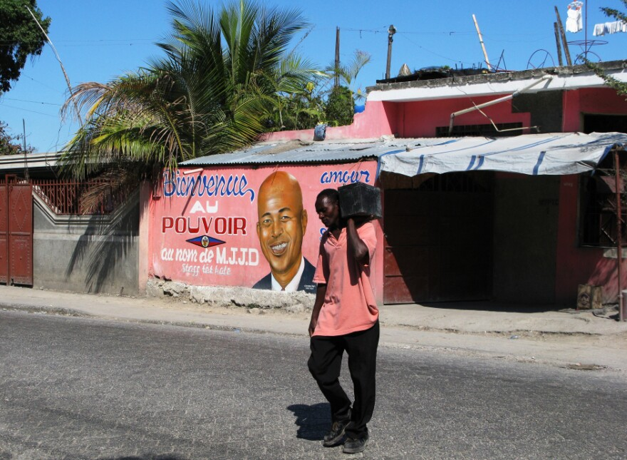 A storefront in Port-au-Prince, Haiti, is brightly painted with a message welcoming President Michel Martelly into power. Two years after a devastating earthquake destroyed much of the Haitian capital, progress is palpable.
