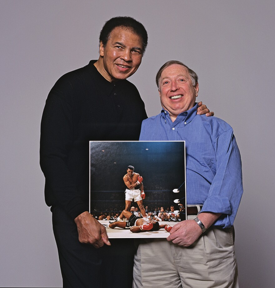 Muhammad Ali with Neil Leifer holding the iconic photograph. Photo from <em>Relentless: The Stories behind the Photographs</em>, by Neil Leifer with Diane K. Shah (University of Texas Press, 2016)