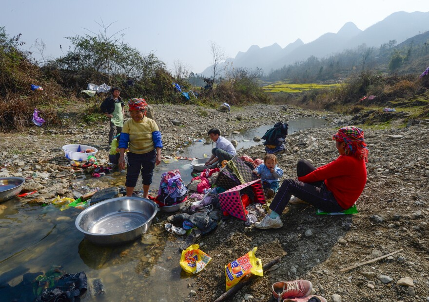 Gansu province, where the family lived, is one of China's poorest. Above, rural residents do their washing.