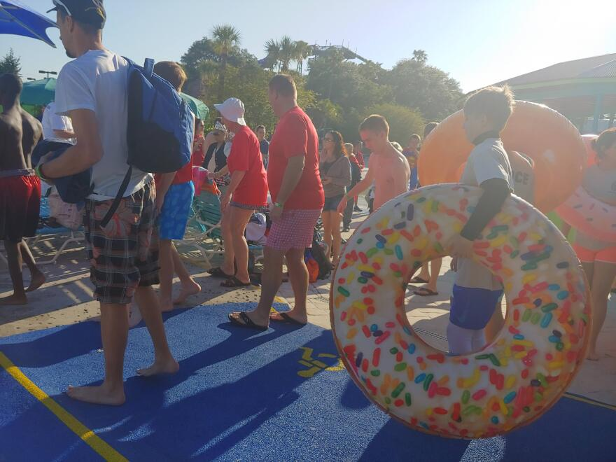 Polar Plunge participants wait to enter the pool at Adventure Island on Saturday, March 23.
