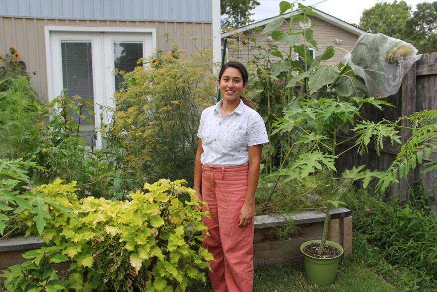 Maisah Khan, river policy director at the Mississippi River Network, stands in her backyard garden in St. Louis.