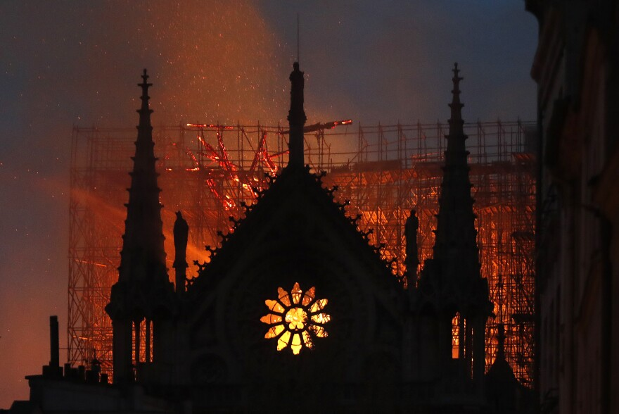 Flames and smoke rise from Notre Dame cathedral as it burns in Paris on Monday.