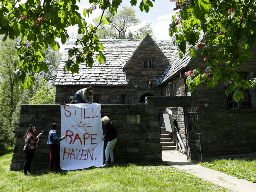 Swarthmore College students hung banners near the Phi Psi fraternity house during a sit-in on Monday. Demonstrators had been protesting after the publication of fraternity documents containing sexist, racist and homophobic comments.