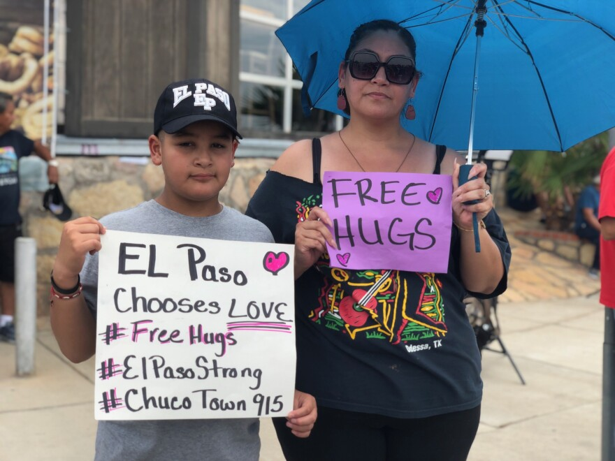 At a memorial near the site of the shooting, Clarissa Hernandez and her son, Ezra Magaooanes, give out free hugs.