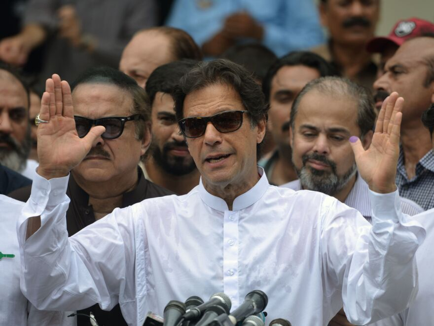 Pakistan's cricket star turned politician Imran Khan speaks to the media after casting his vote in Islamabad on July 25.