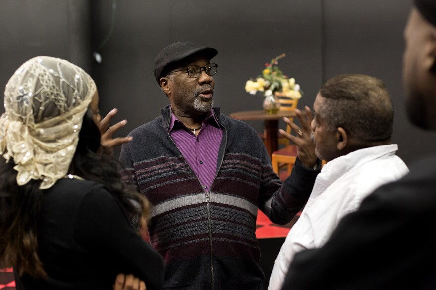 Ron Himes, artistic director and founder of the Black Rep, speaks with cast members during rehearsal. Feb. 18, 2020