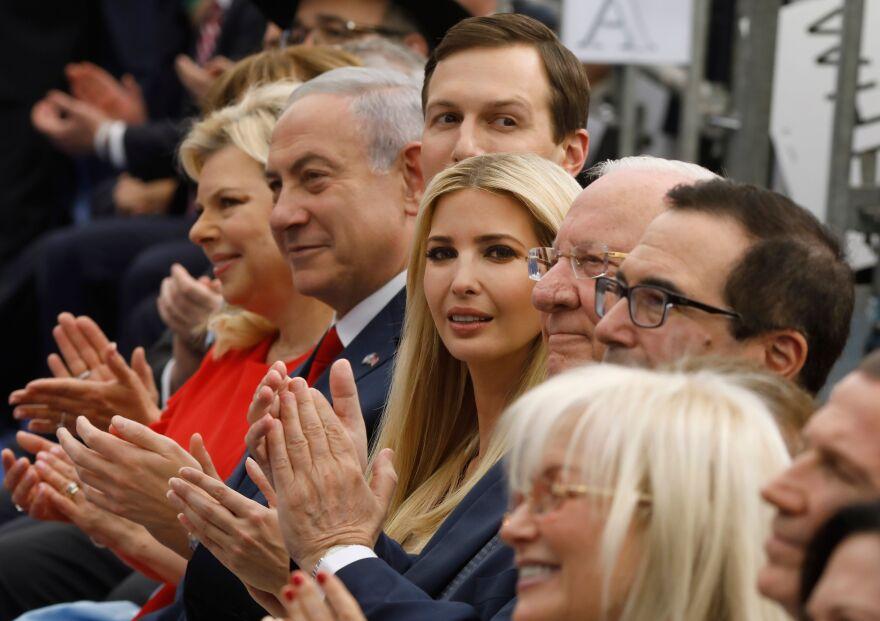 Israel's Prime Minister Benjamin Netanyahu (second left), his wife Sara Netanyahu (left), Senior White House Advisor Jared Kushner (third left), President Trump's daughter Ivanka Trump (center), U.S. Treasury Secretary Steve Mnuchin (right) and Israel's President Reuven Rivlin (second right) applaud at the opening of the U.S. Embassy in Jerusalem on Monday.