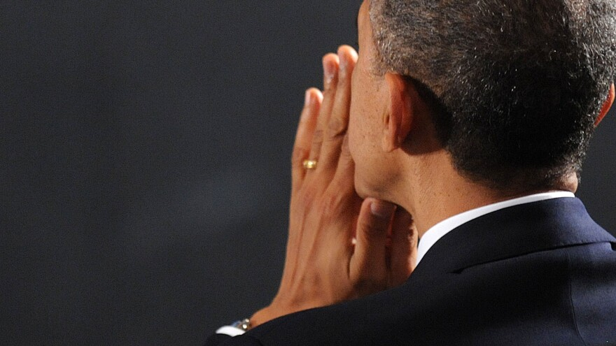 President Obama at an interfaith vigil for the shooting victims at Sandy Hook Elementary School in 2012.