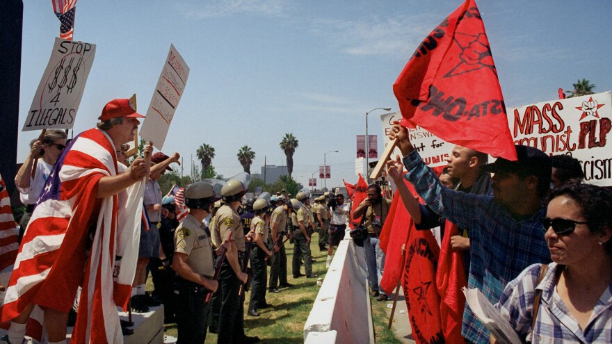 Activists for and against Proposition 187 rallied in Los Angeles in 1996, after it was thrown out by the courts. Political analysts say tough rhetoric and laws targeting illegal immigration could now have lasting political consequences for the national Republican Party.