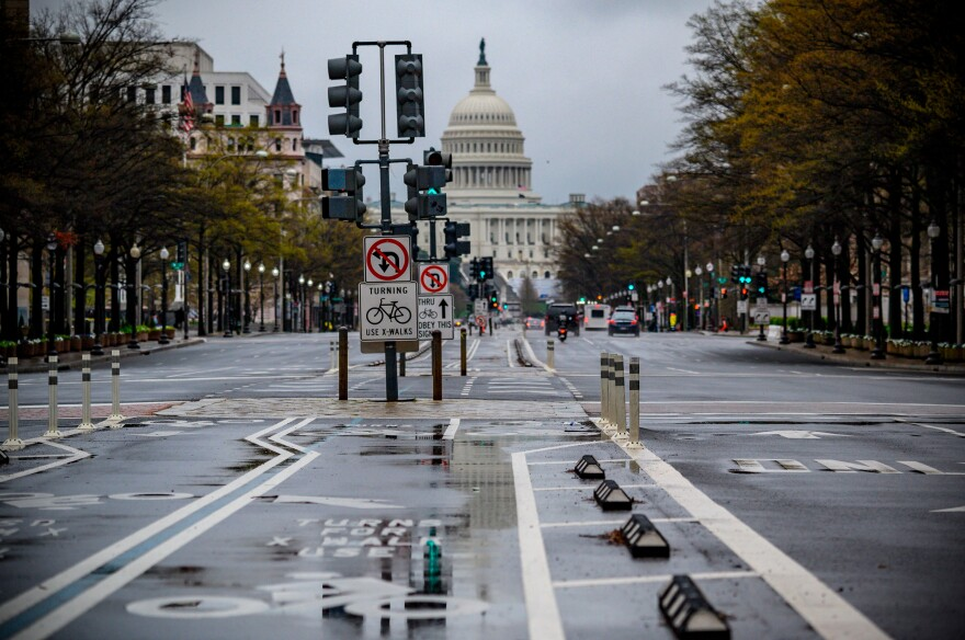 After weeks of social distancing, streets in Washington, D.C., and many other towns and cities are often empty. The pressure is growing to get society moving again.