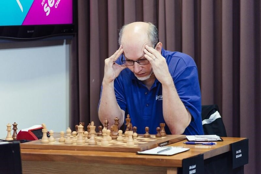 GM Joel Benjamin concentrates on his move during Round 8 of the U.S. Senior Championships in 2019.