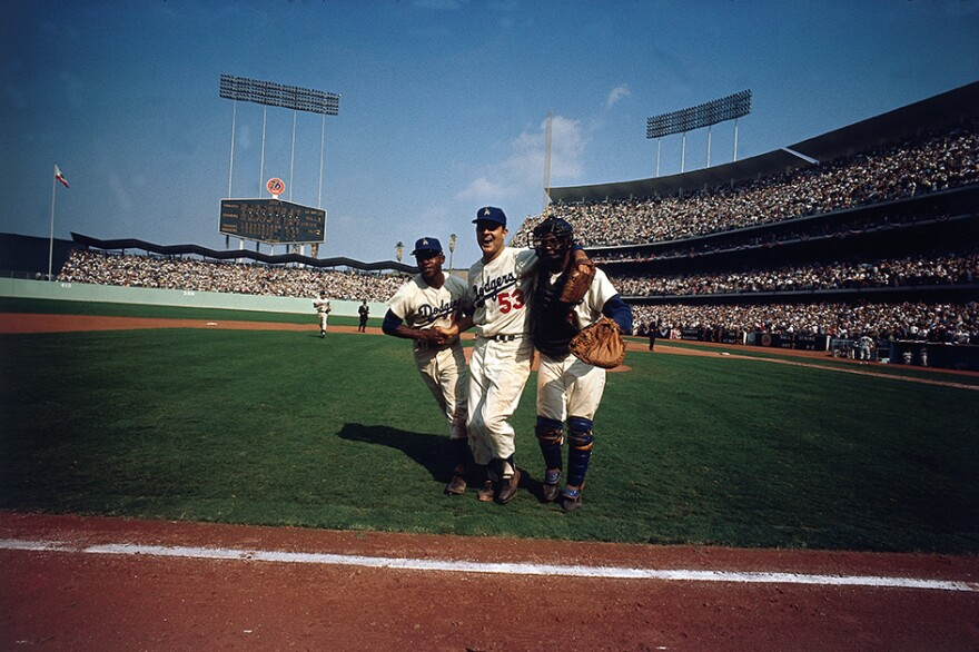 Leifer's shot of the victorious Dodgers at the 1963 World Series Jim Gilliam(left), with Don Drysdale and John Roseboro at Dodger Stadium in Los Angeles. Photo from <em>Relentless: The Stories behind the Photographs</em>, by Neil Leifer with Diane K. Shah (University of Texas Press, 2016)