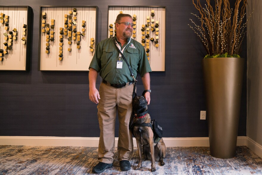 Brett Simon, president and co-founder of K9s for Warriors organization, stands with his dog Lincoln at the Association of Service Dog Providers for Military Veterans annual conference in Tyson's Corner, Va. The nonprofit bills itself as the largest provider of psychiatric service dogs for veterans.