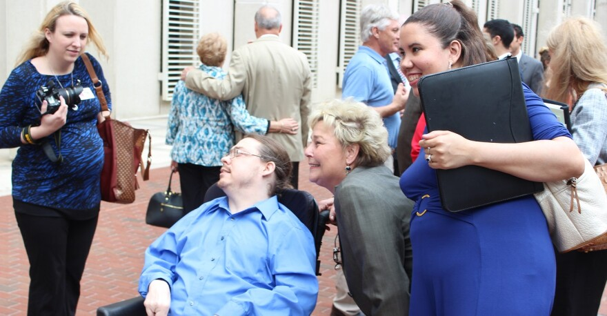APD Director Barbara Palmer (in gray) with supporters during Developmental Disabilities Awareness Day at the Capitol