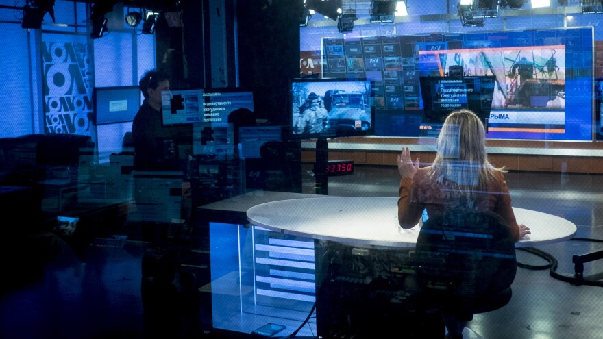 Journalist Natasha Mozgovaya co-anchors <em>Current Time</em> in Washington, D.C., in 2015. It's produced by Radio Free Europe in cooperation with Voice of America, a government-funded news arm.