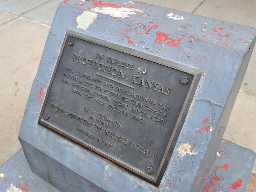 In Protection, Kansas, the town's role in kicking off the polio vaccination campaign in 1957 remains a point of pride memorialized by this small monument in front of the old post office.