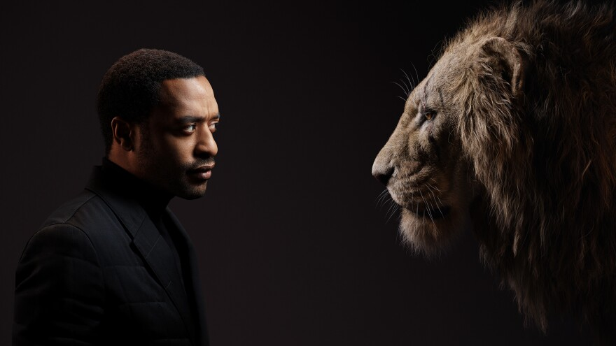 Chiwetel Ejiofor and his onscreen counterpart in 2019's <em>The Lion King</em>, the power-hungry villain Scar.