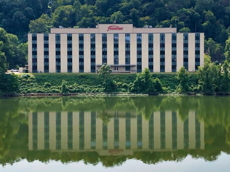 The Frontier Communications building sits along the Kanawha River in Charleston