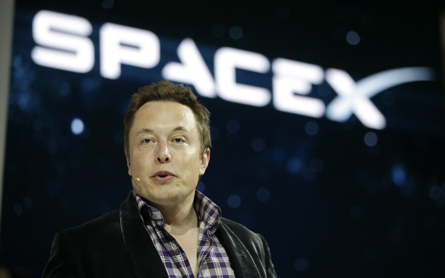 Elon Musk, CEO and CTO of SpaceX, introduces the Dragon V2 spaceship at the company's headquarters in Hawthorne, Calif., in May 2014. Musk predicted during an interview at the Code Conference in Southern California on June 1 that people would be on Mars in 2025.