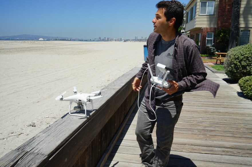 Juliano Calil prepares to launch his drone over Long Beach, Calif., for a virtual reality program he's creating to simulate the effects of sea level rise on the area.