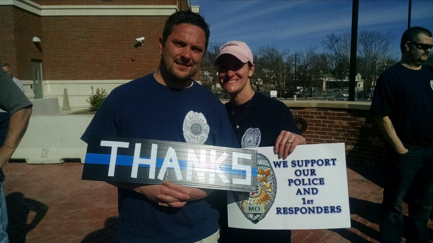 Donning t-shirts supporting former Ferguson officer Darren Wilson, Eddie and Jill Trueman attended Sunday's demonstration to show support for law enforcement officers.