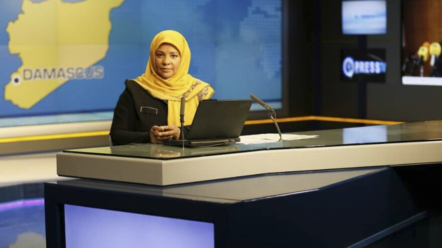 American-born news anchor Marzieh Hashemi sits in a studio in Tehran where she works for Iran's state television. She was arrested Sunday during a visit to the U.S., her family says. She is testifying behind closed doors to a grand jury in Washington, D.C., in an unspecified case, a U.S. judge said Friday.