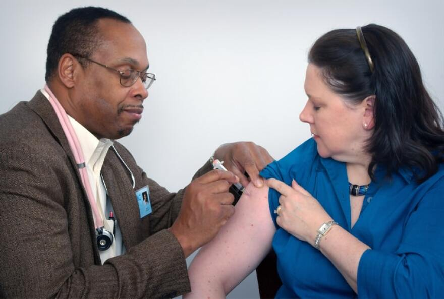 vaccine_doctor_gives_injection_to_woman_in_arm___cdc.jpg