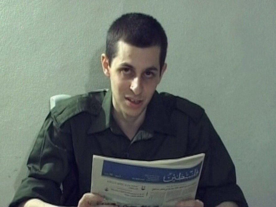 <p>In this video grab released on Oct. 2, 2009, captured Israeli soldier Gilad Shalit is seen holding a Palestinian newspaper. Shalit, who has been held by Palestinians for more than five years, is set to be released Tuesday.</p>