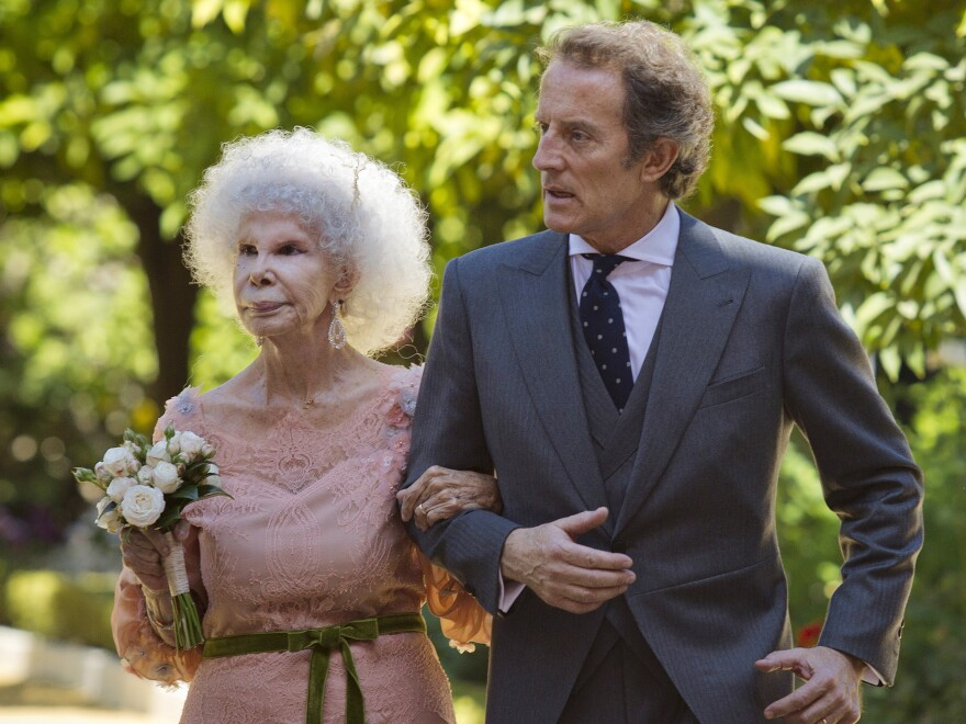 Maria del Rosario Cayetana Fitz-James Stuart, the Duchess of Alba, and her husband, Alfonso Diez, walk out of the chapel after their wedding at Las Duenas Palace in Seville on Oct. 5, 2011. The duchess died Thursday. She was 88.
