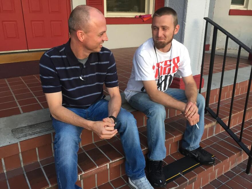 Justin Heath (left) and Marcus Lynch (right) chat after a support group meeting for addicts in recovery.