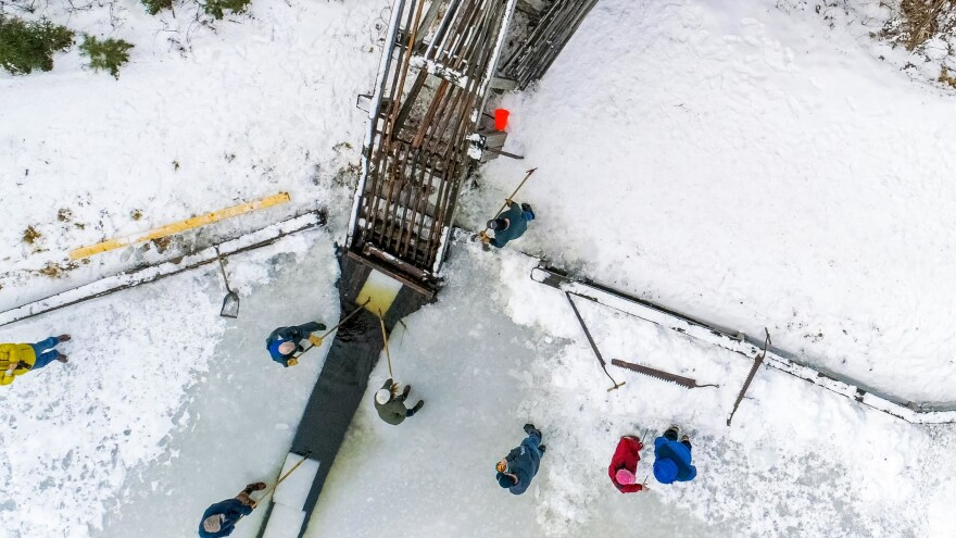 Birds eye view of the wooden ramp as the ice blocks are loaded.