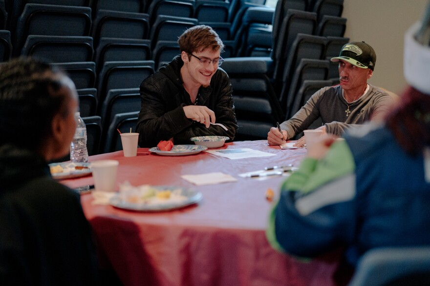 Harrison Schapelhouman (center) shares a moment with members of an addiction and family support group led by his mother on Dec. 8, 2019, after the community church service at True Hope Community Church in Issaquah, Wash.