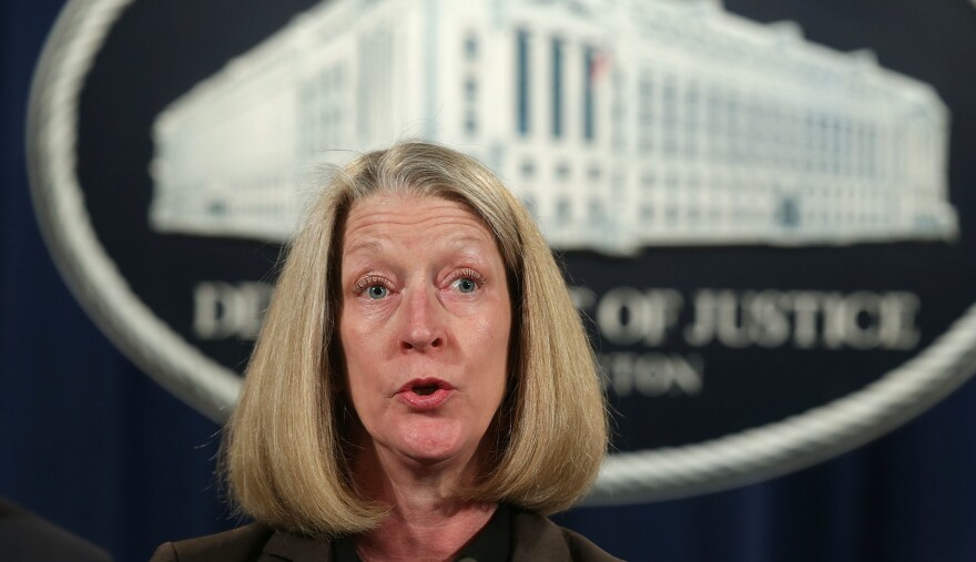 Acting Assistant Attorney General Mary McCord speaks during a news conference at the Justice Department on March 15. McCord told staff members she will be leaving next month.